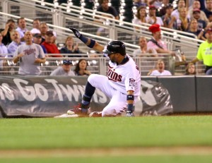 Minnesota Twins Outfielder Eddie Rosario (20) slides into third base during the game between the Detroit Tigers and the Minnesota Twins at Target Field, Minneapolis Minnesota.,