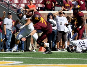 September 19, 2015: University of Minnesota Gopher quarterback Mitch Leidner (7) runs for a touchdown,and is tripped up, in the game between the Kent State Golden Flash and the University of Minnesota Gophers at TCF Bank Stadium in Minneapolis,Minnesota.September 17, 2015: University of Minnesota Gopher fullback Jeremy Seaton (44) during the game between the Kent State Golden Flash and the University of Minnesota Gophers at TCF Bank Stadium in Minneapolis,Minnesota.